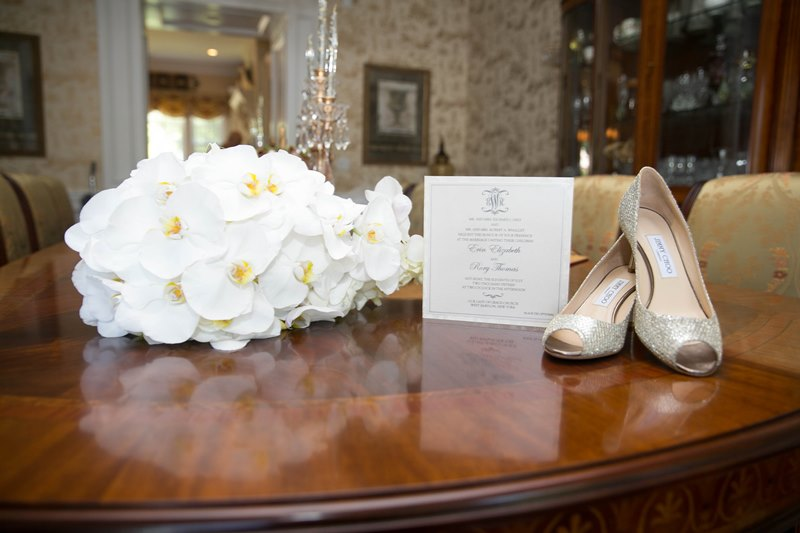 invitation with shoes and flowers
