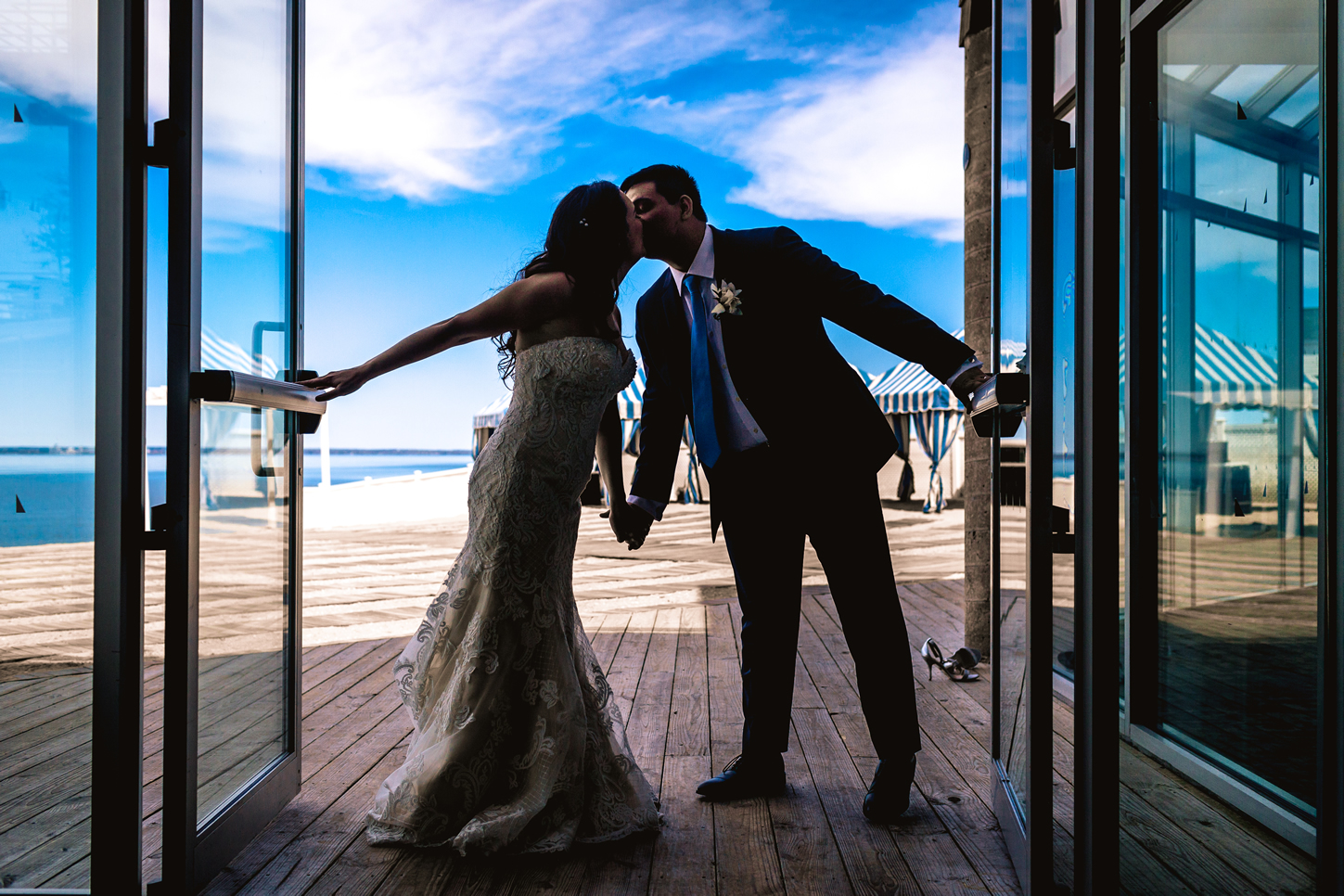 bride and groom kissing crescent beach club