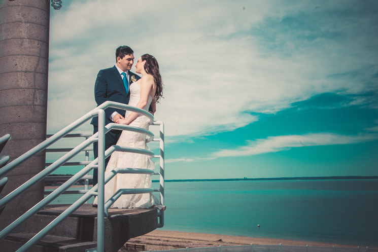 bride and groom on balcony Crescent Beach Club