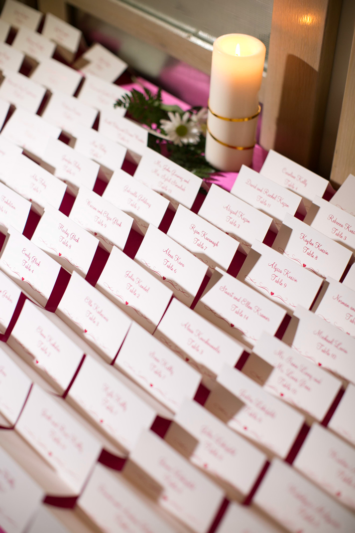 seating cards with pink writing