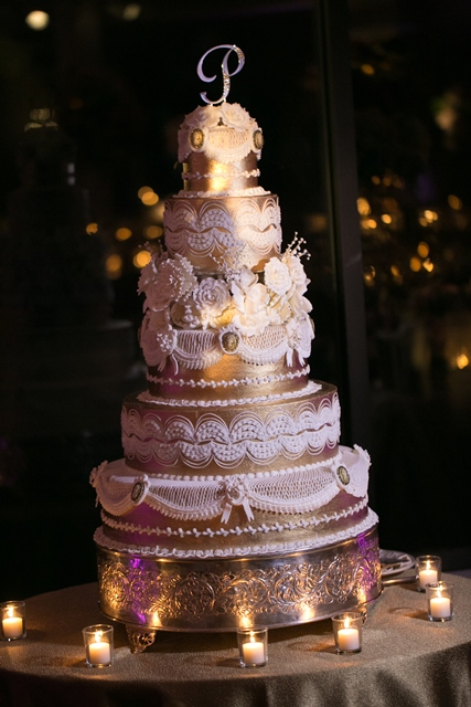 full view of gold cake with cake topper at oheka