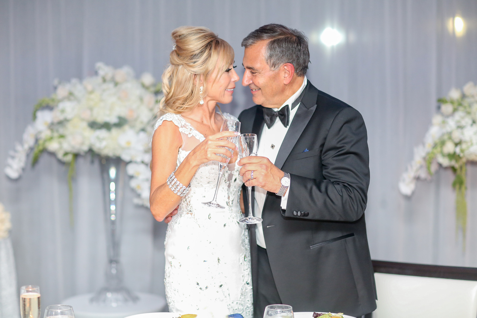 Bride and Groom Toast Harbor Club at Prime